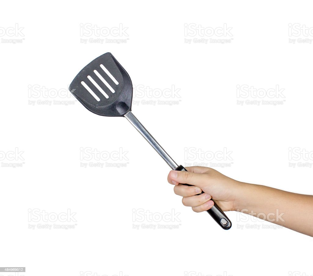 hand holding flipper frying isolated on white background stock photo