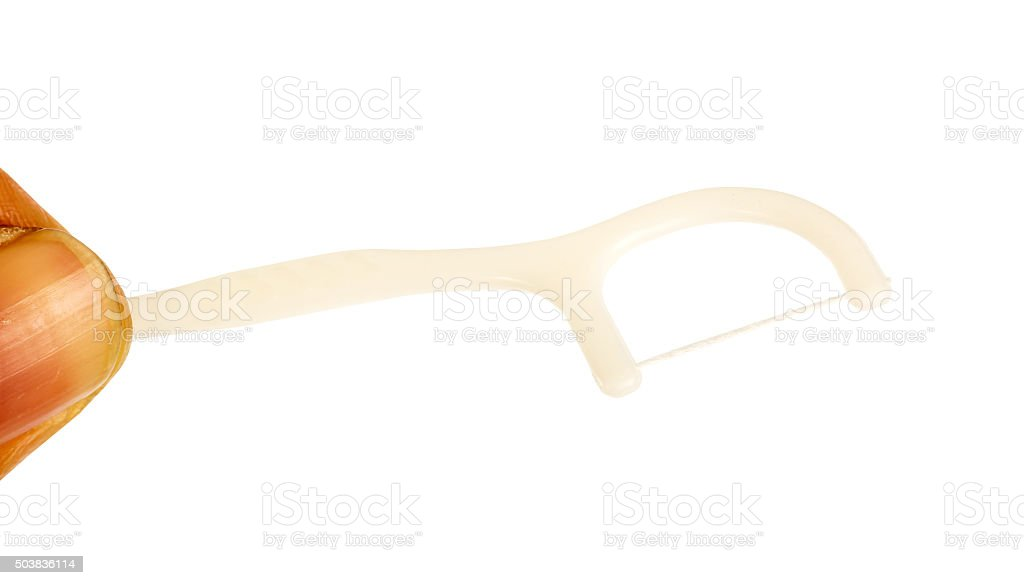 Hand holding Floss toothpick stock photo