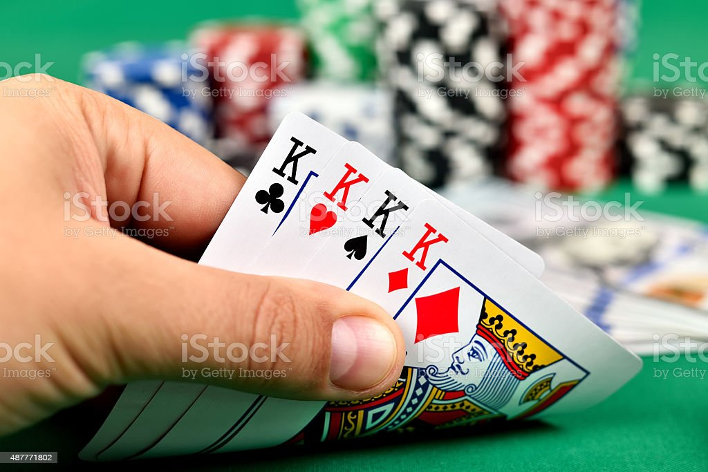 hand holding four kings stock photo