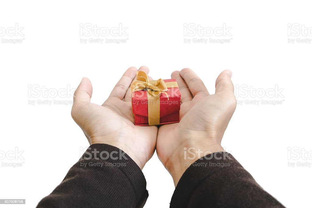 Hand holding gift box, isolated on white background stock photo