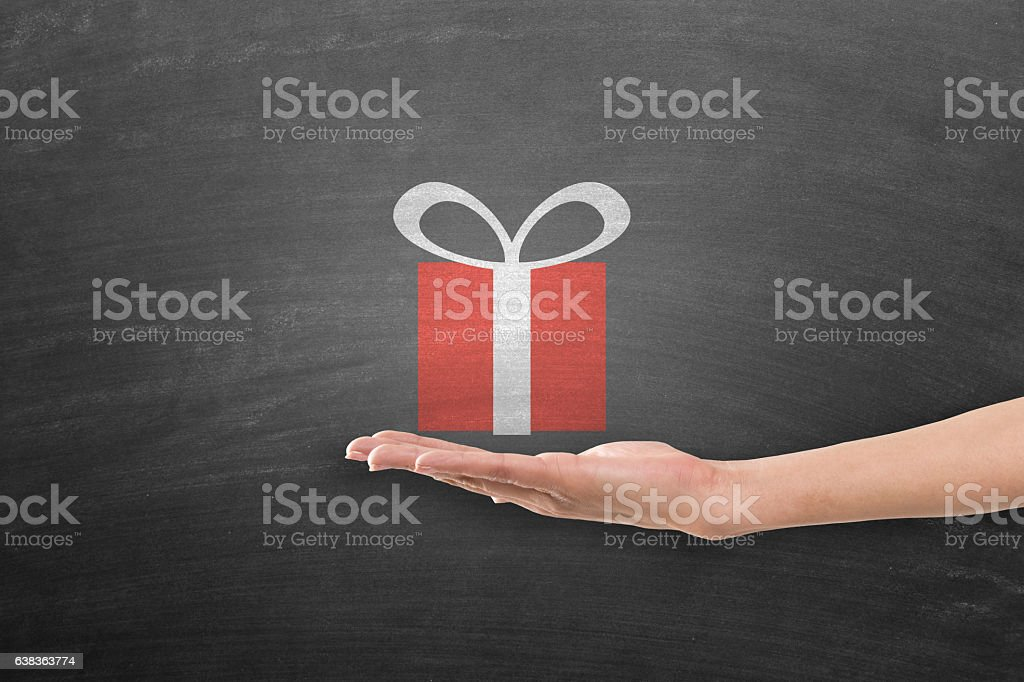 Hand holding gift stock photo
