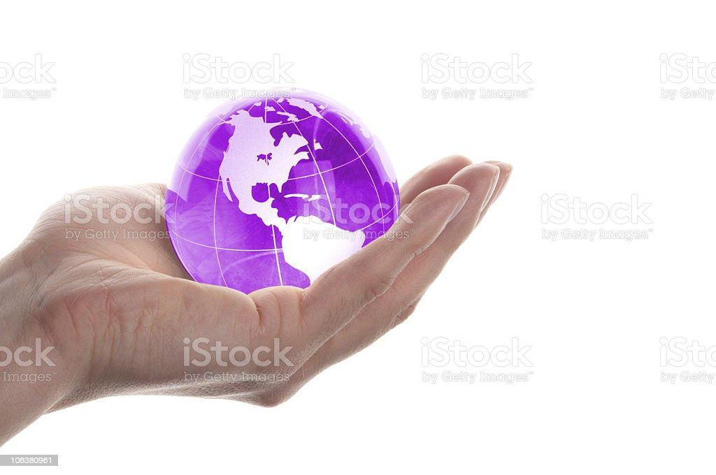 hand holding globe stock photo