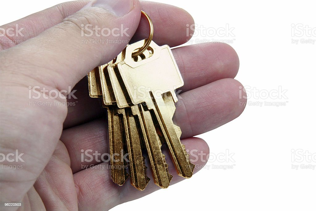 hand holding golden key stock photo