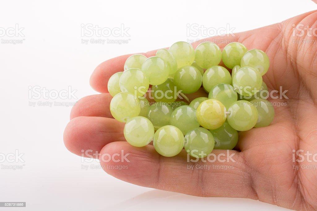 Hand holding green beads stock photo