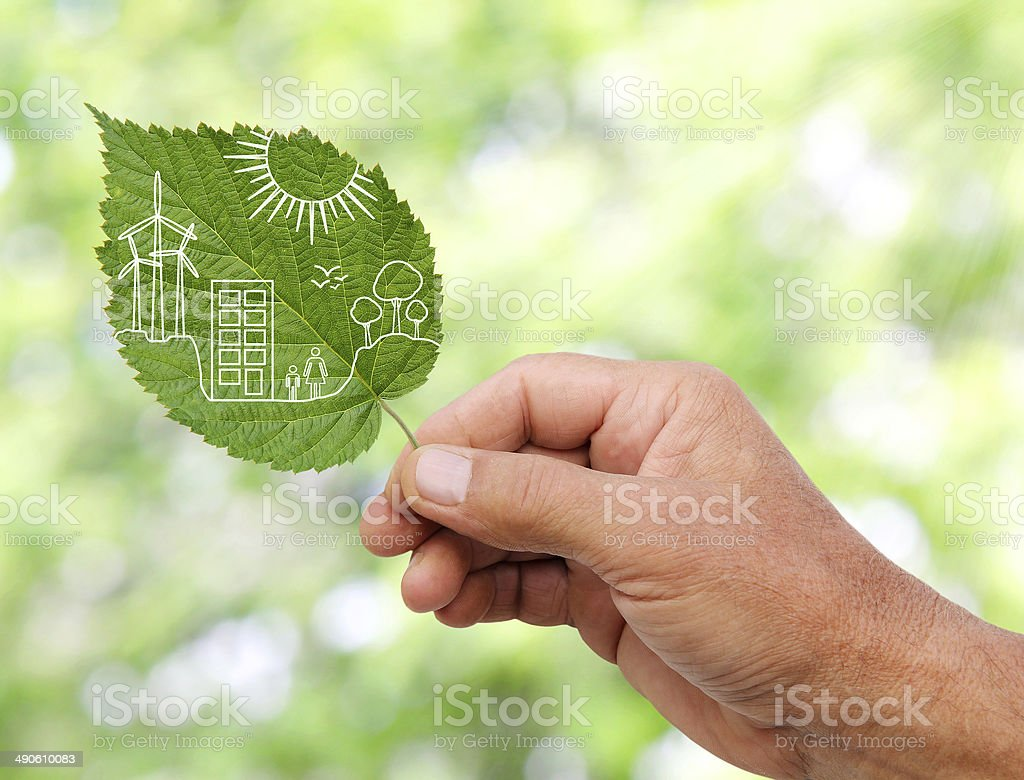 hand holding Green city concept, cut the leaves of plants royalty-free stock photo