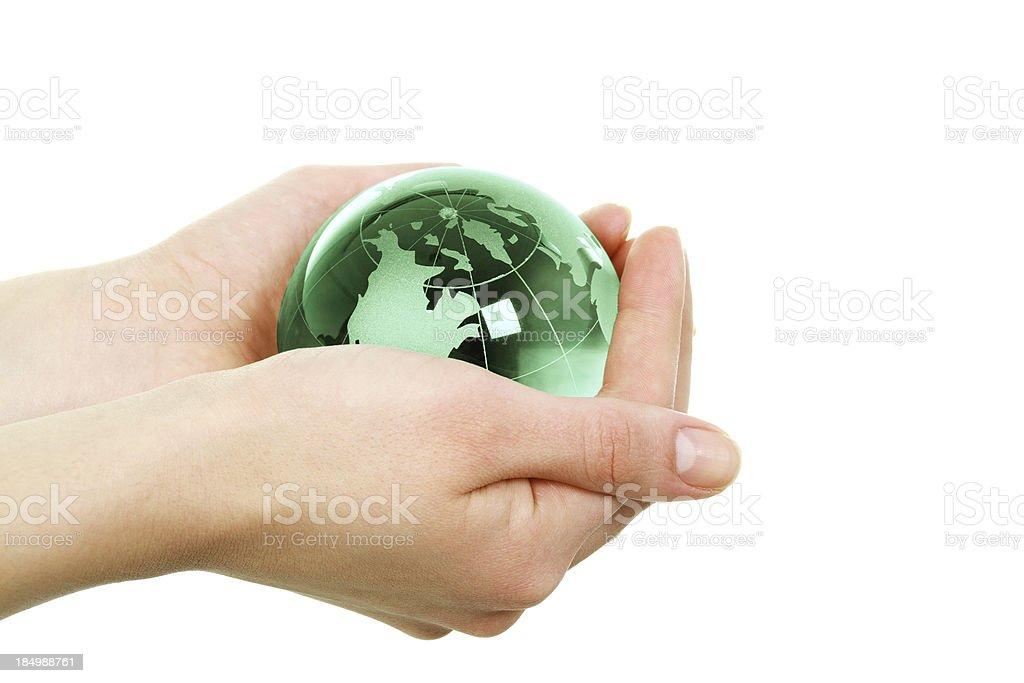 Hand Holding Green Globe stock photo