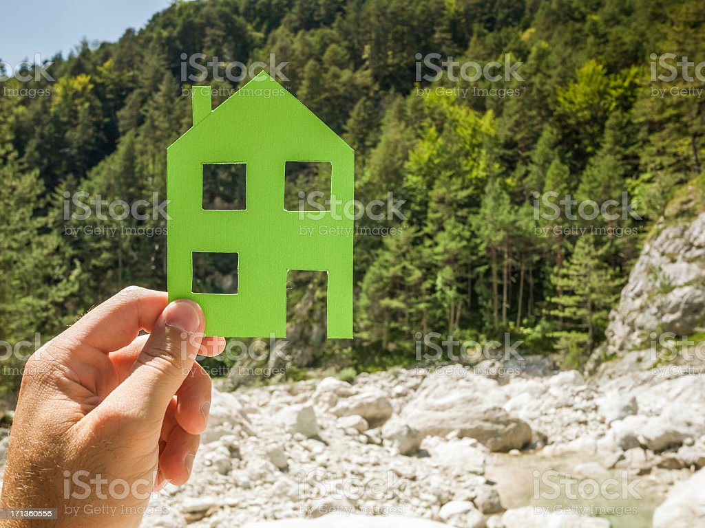 Hand holding green house against nature royalty-free stock photo