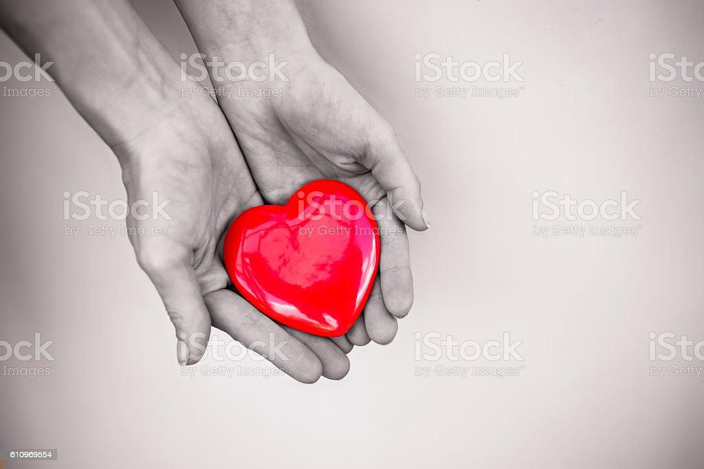 Hand holding heart stock photo