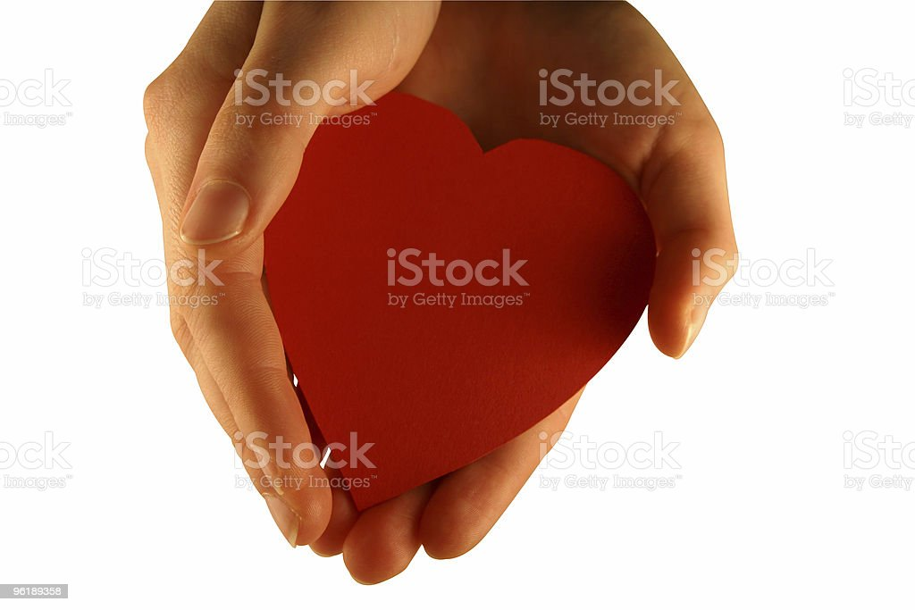 Hand holding heart (with clipping path) stock photo