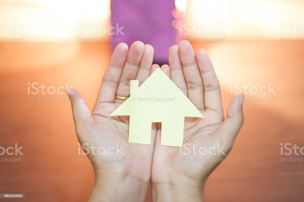 Hand Holding Home shape from paper, Real Estate Business Template stock photo