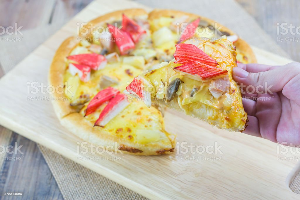 Hand holding homemade pizza royalty-free stock photo
