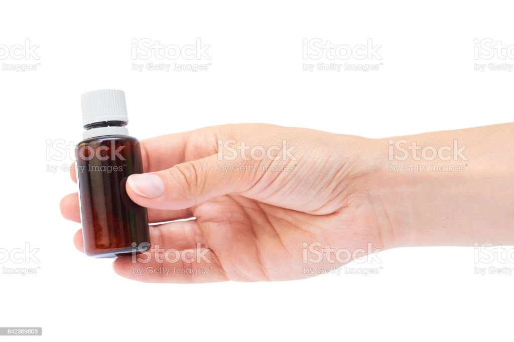Hand holding homeopathic pills isolated on white background stock photo