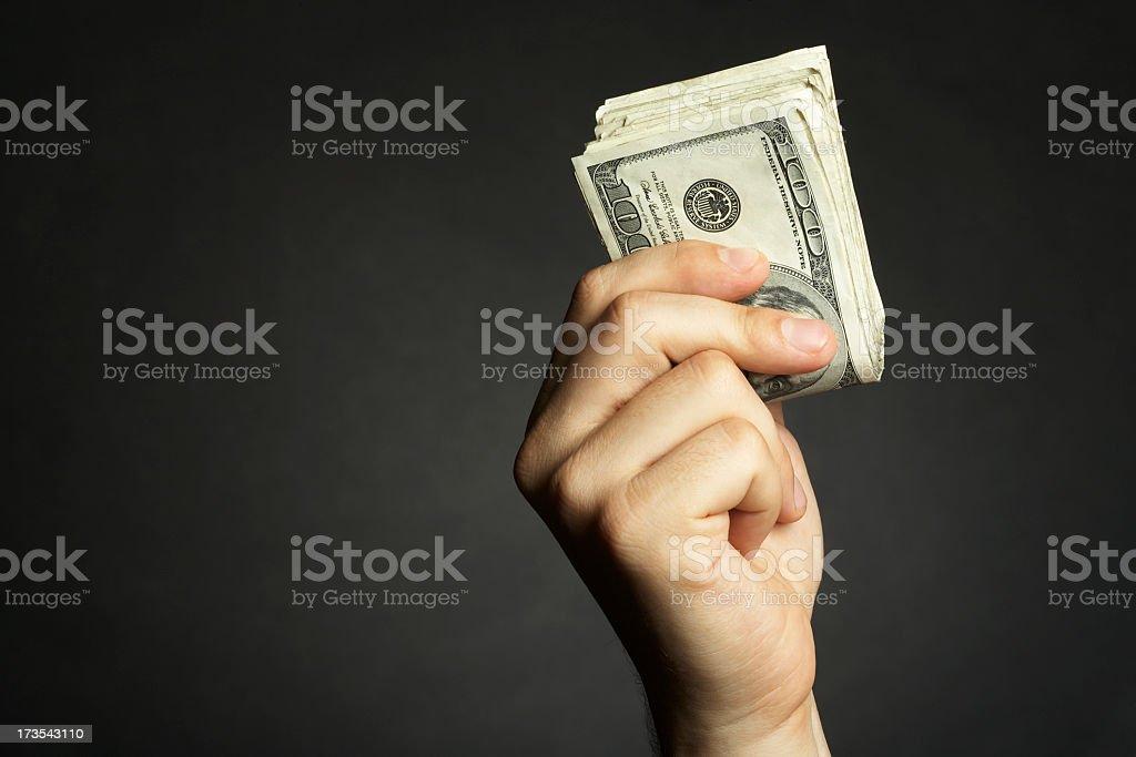 Hand holding hundred dollars bills sheaf stock photo