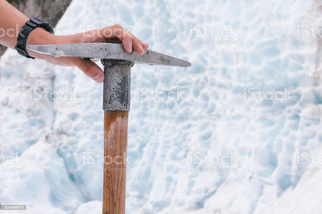 Hand holding Ice axe on Franz Josef Glacier, New Zealand stock photo
