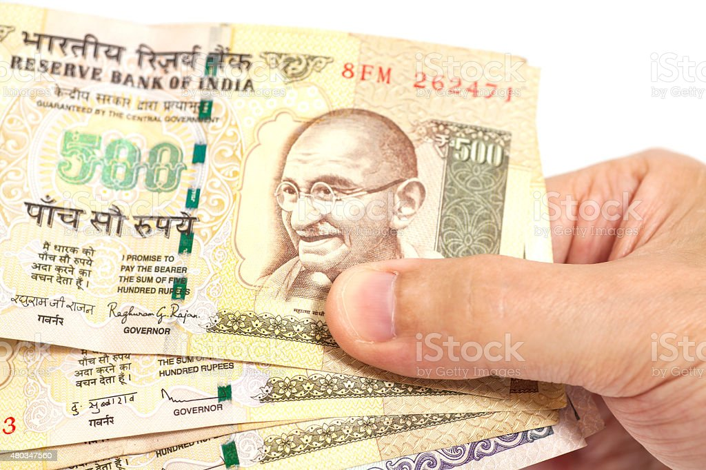 Hand holding Indian five hundred rupee notes stock photo