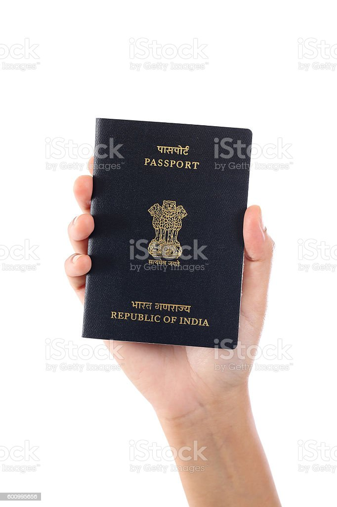 Hand holding Indian passport against white background stock photo