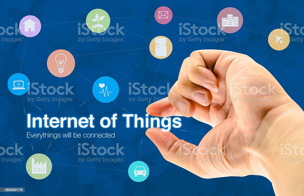 Hand holding Internet of things (IoT) word and icon stock photo