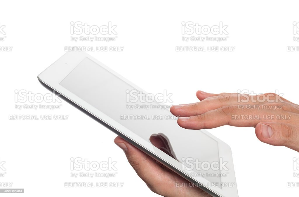 hand holding ipad and ready to touch screen stock photo