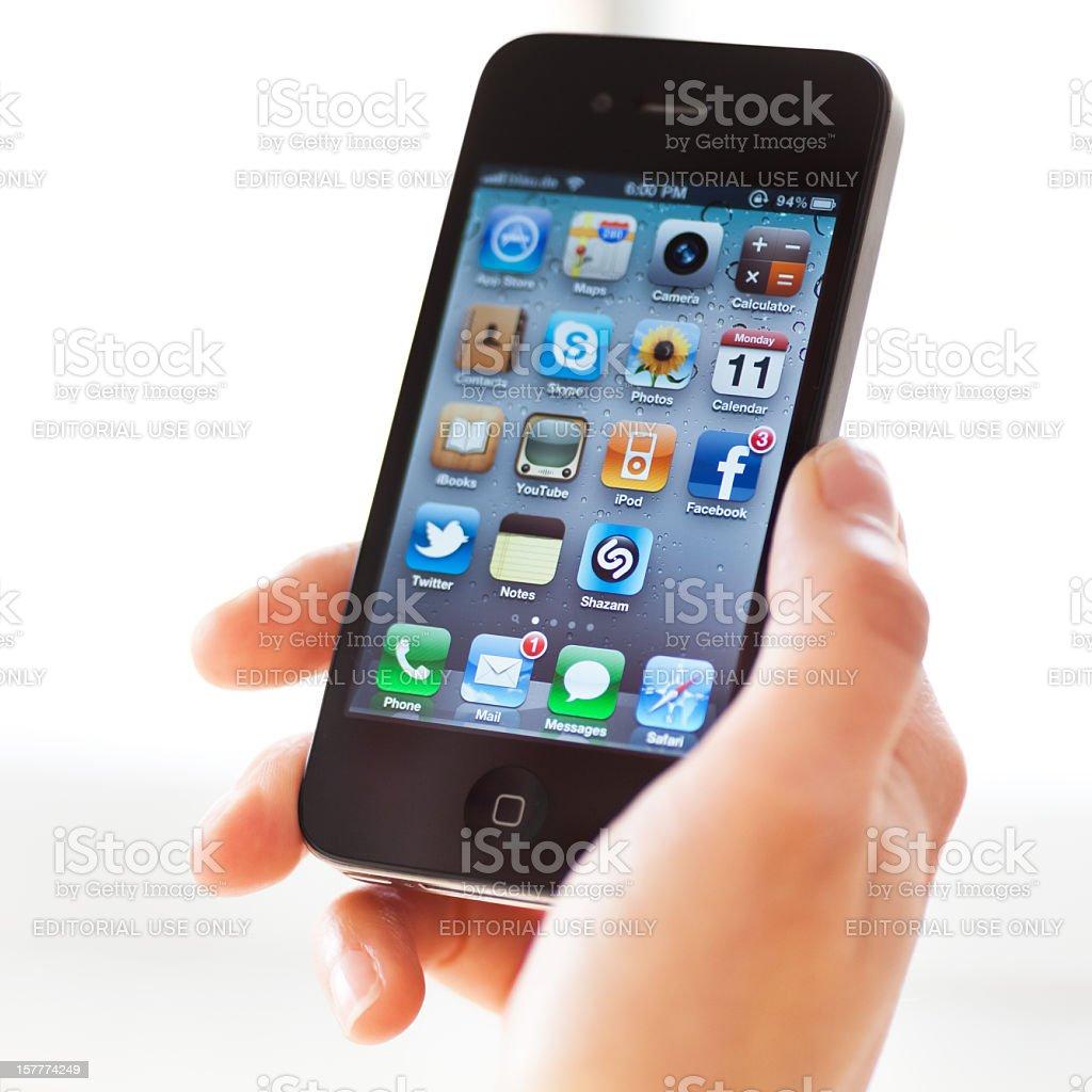 Hand holding Iphone 4 stock photo