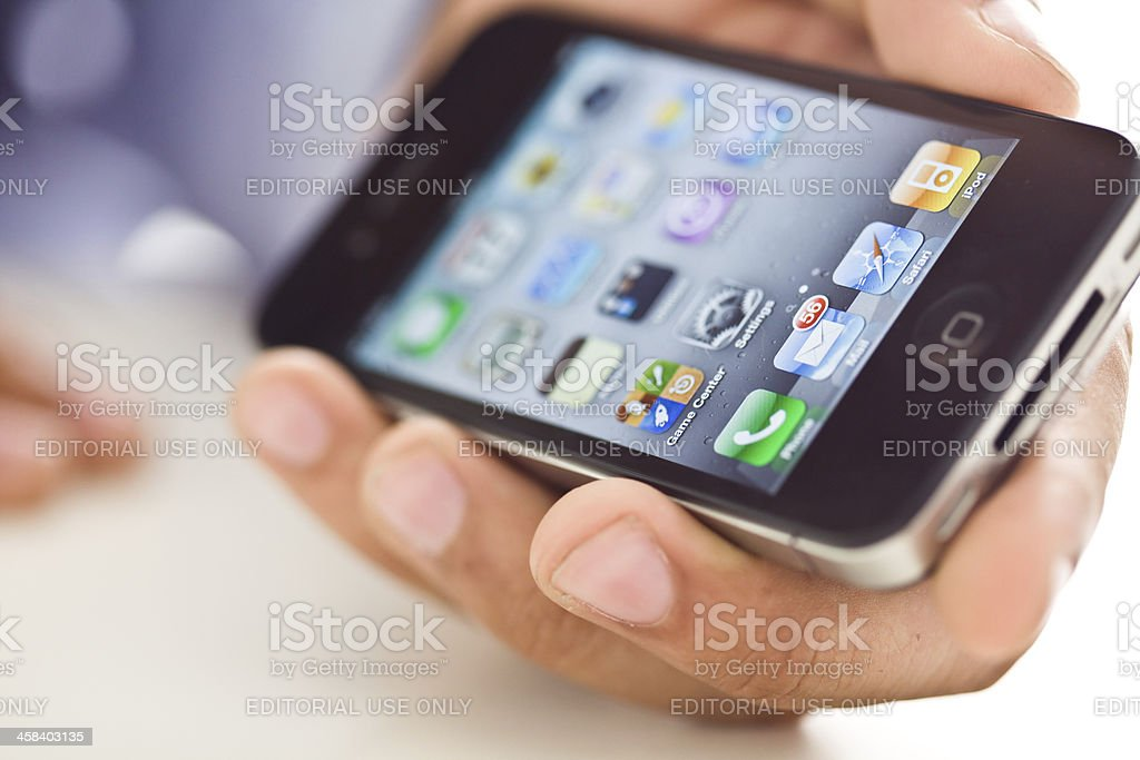 Hand holding iPhone 4 royalty-free stock photo