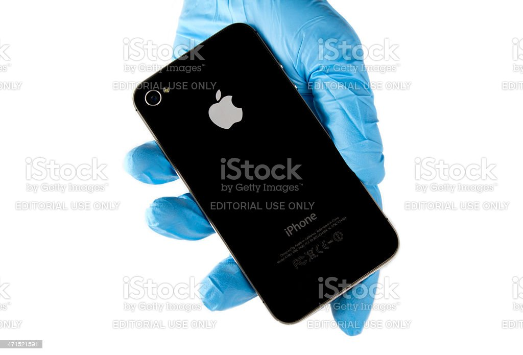 Hand holding Iphone 4 stock photo