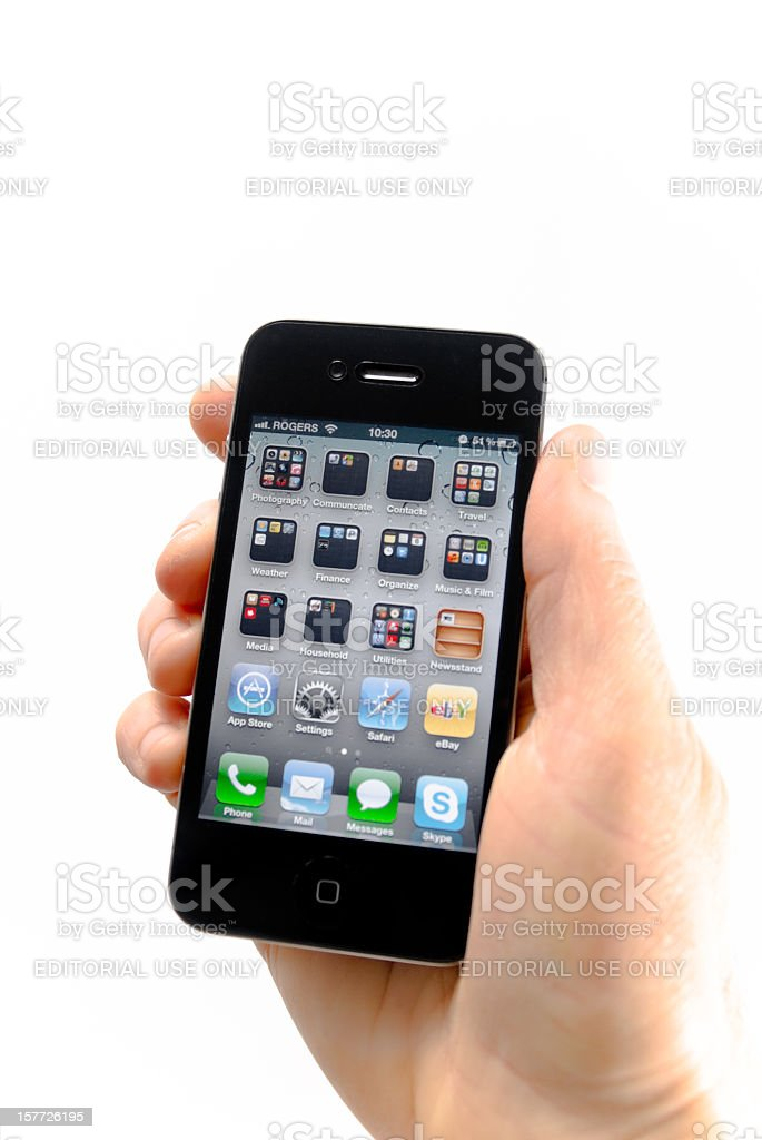 Hand Holding iPhone 4 S royalty-free stock photo