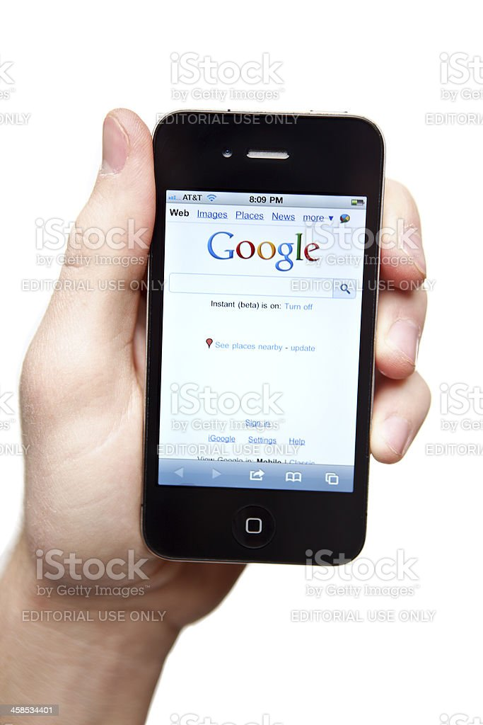 Hand holding iPhone 4 with Google on the screen. royalty-free stock photo