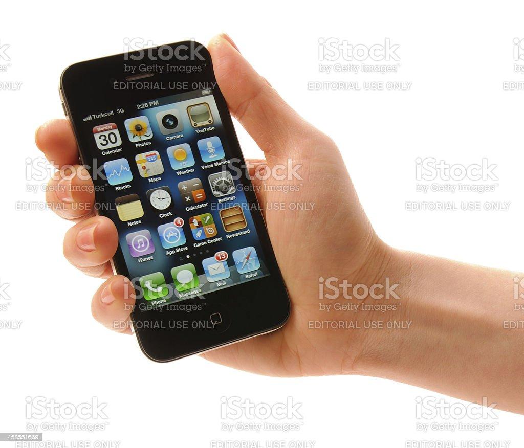 Hand holding Iphone 4s stock photo