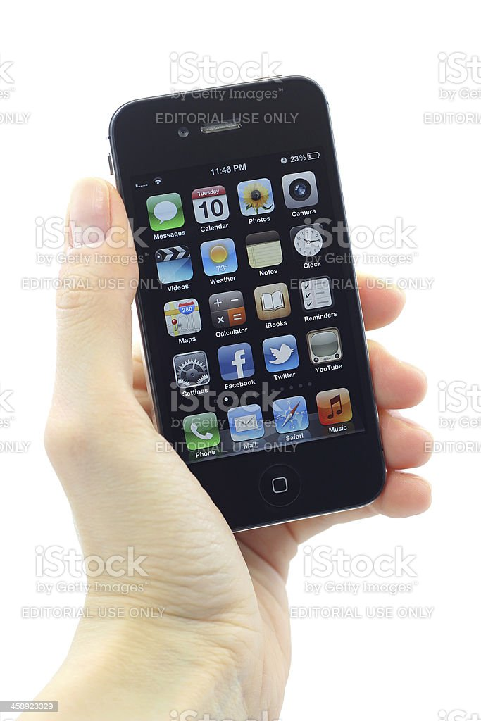 Hand holding iphone 4S stock photo