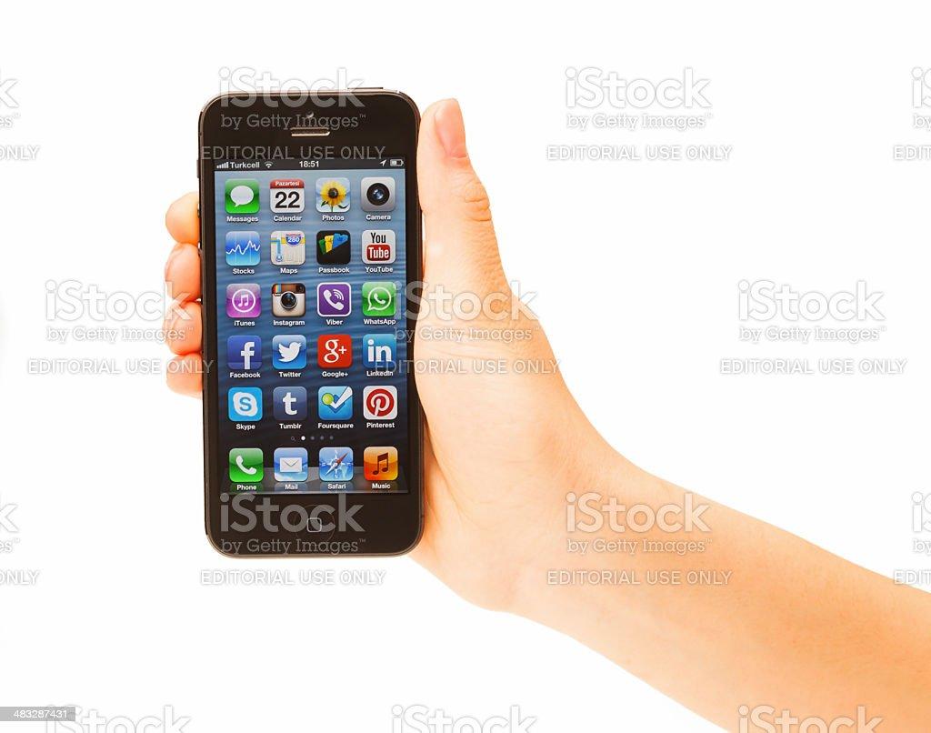 Hand holding Iphone 5 stock photo