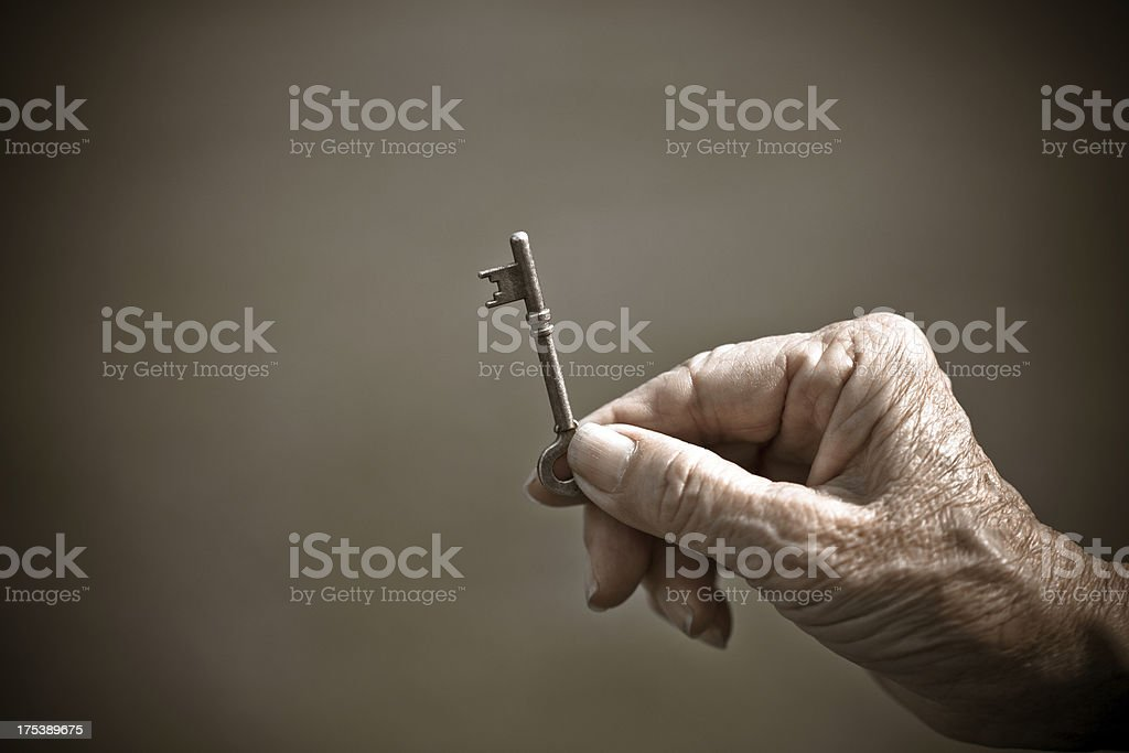 Hand holding key to success stock photo