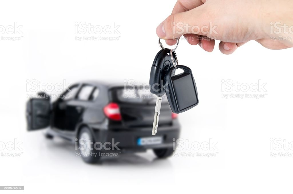 Hand holding keys to new car stock photo