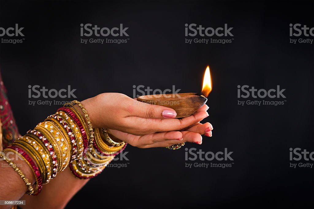 hand holding lantern during diwali festival of lights stock photo