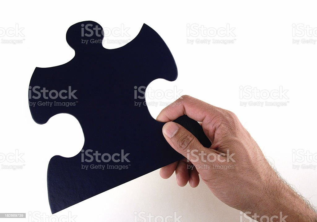 Hand Holding Large Puzzle Piece stock photo