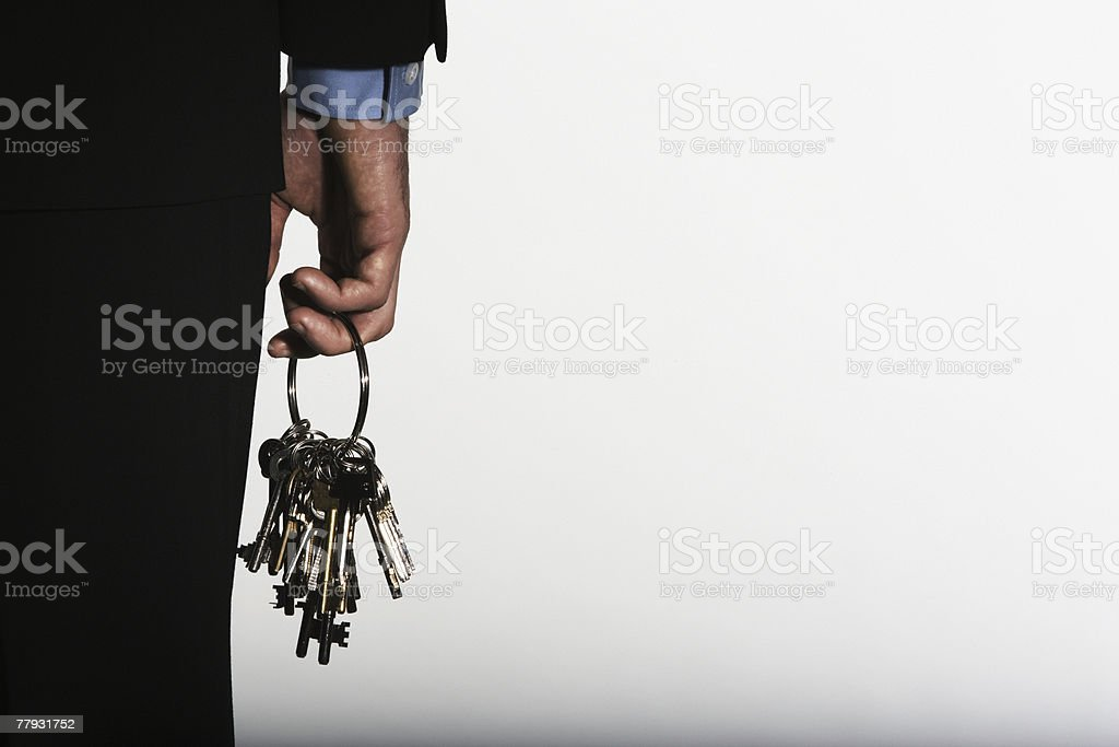 Hand holding large ring of keys royalty-free stock photo