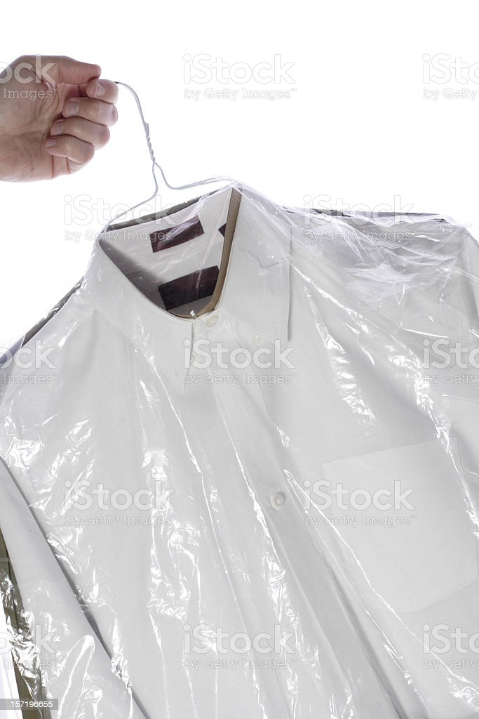 Hand Holding Laundered Shirts on Hangers royalty-free stock photo