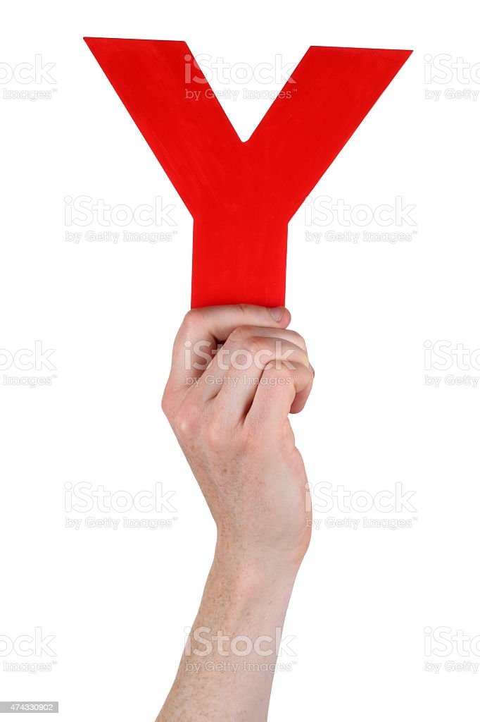 Hand holding letter Y from alphabet stock photo