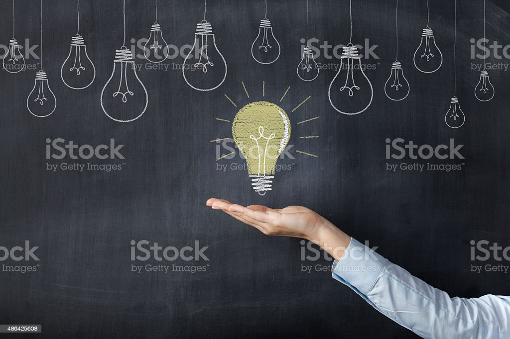 Hand holding light bulb stock photo