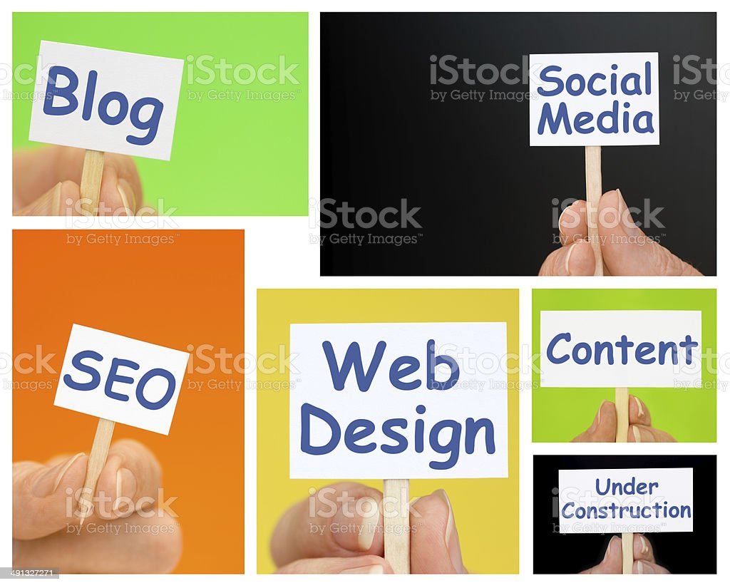 Hand holding Little Signs with Web Design Text royalty-free stock photo