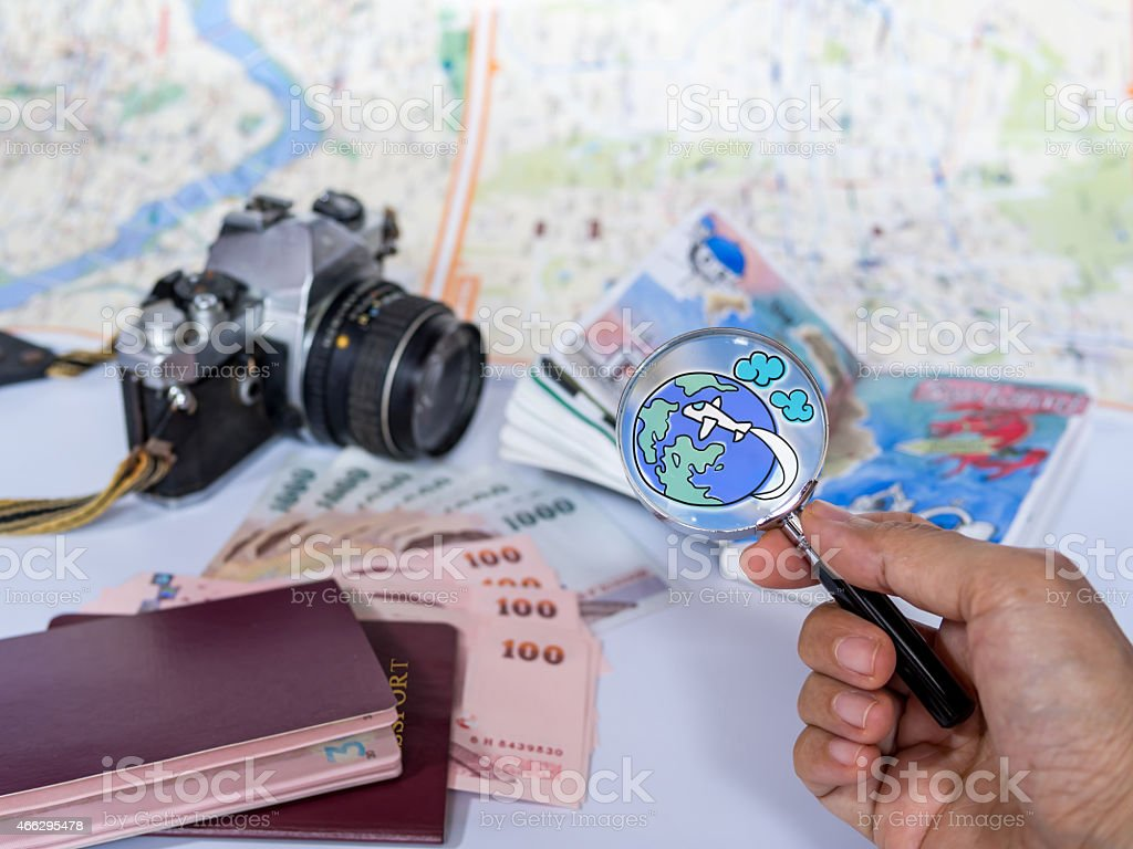 Hand holding magnifying glass, finding for dream destination/ traveling concept stock photo