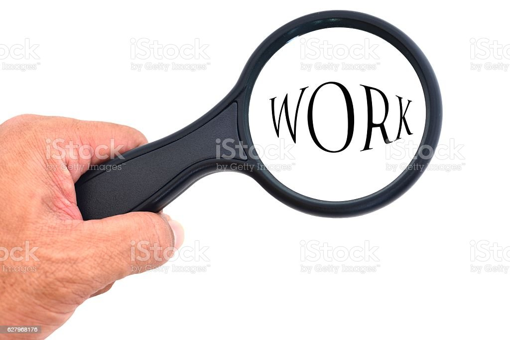 Hand holding magnifying glass with words search work. stock photo