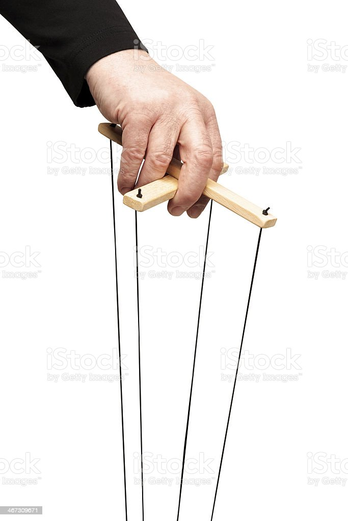 hand holding marionette control bar stock photo