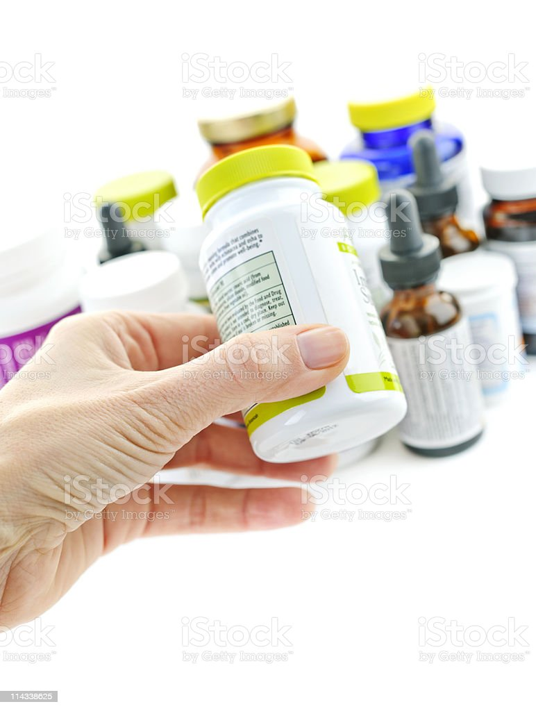 Hand holding medicine bottle royalty-free stock photo