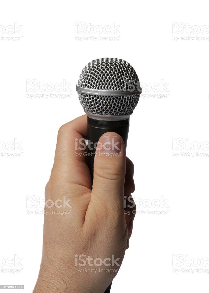 Hand holding mic stock photo