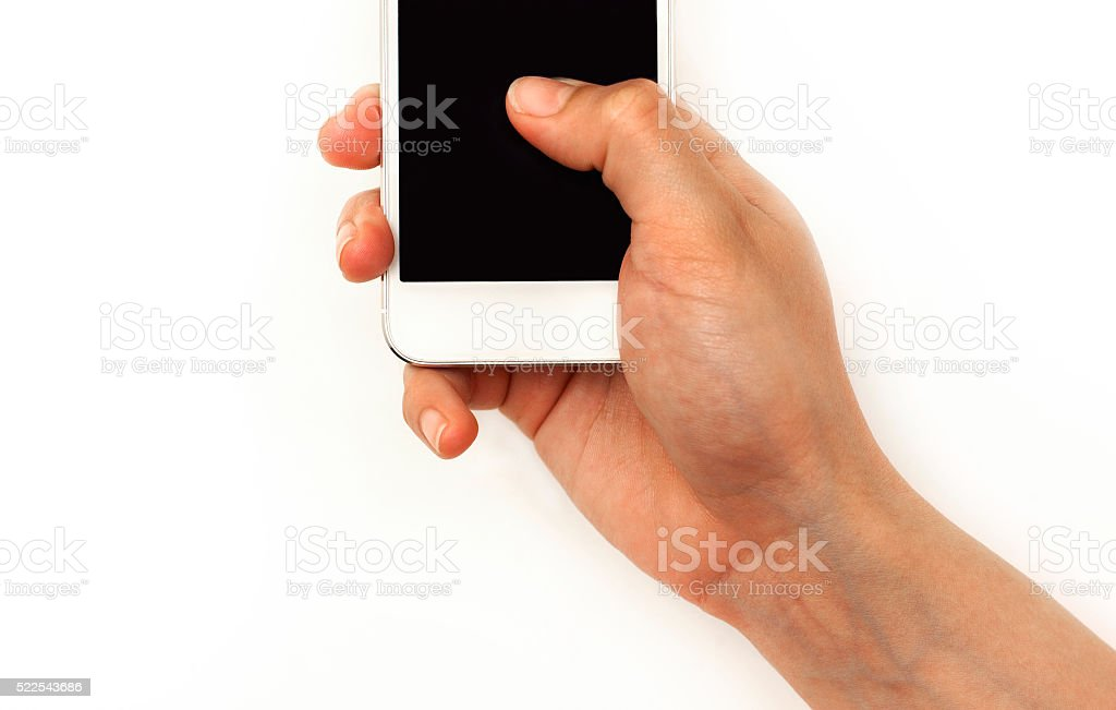 Hand holding mobile phone, pressing with thumb on screen stock photo