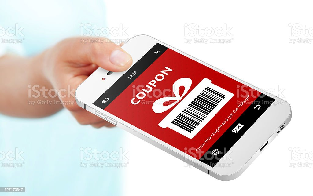 hand holding mobile phone with christmas coupon over white stock photo