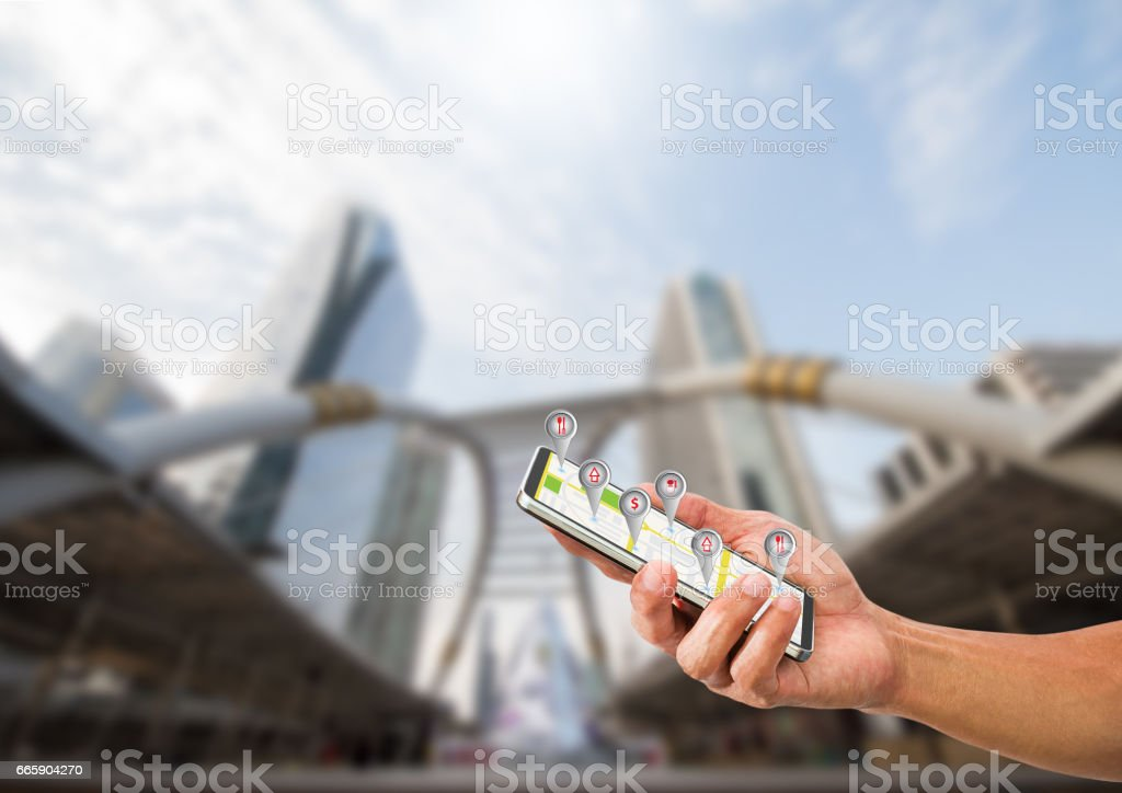 Hand holding mobile phone with navigation symbol stock photo