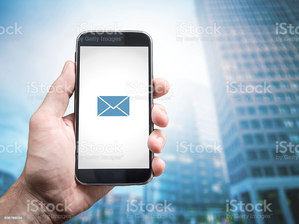 Hand holding mobile smart phone with message on a screen stock photo