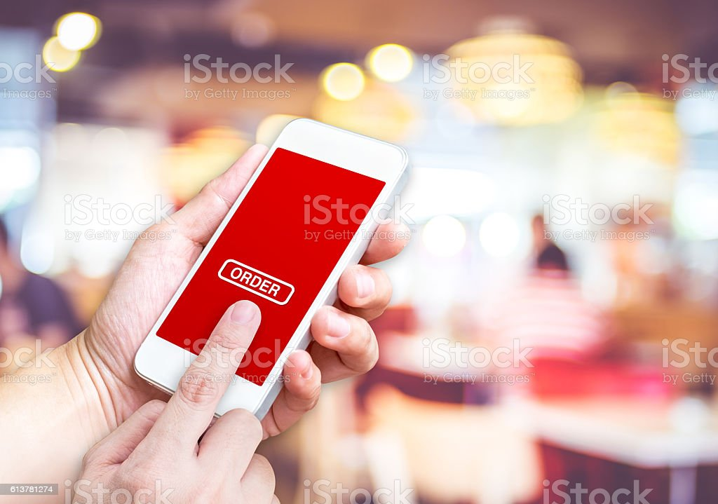 Hand holding mobile  with order button and empty screen stock photo