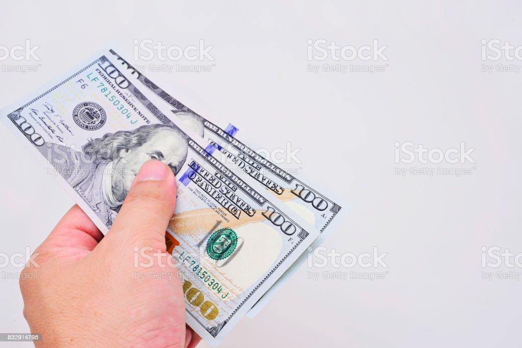 Hand holding money US dollars stock photo